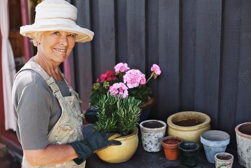 Smiling older woman gardening
